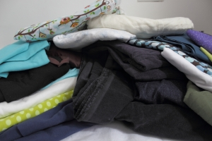 Dark ones in the middle are cords and denim, top is flannel, left is knits, right is quilting weight cottons, and the olive is linen...